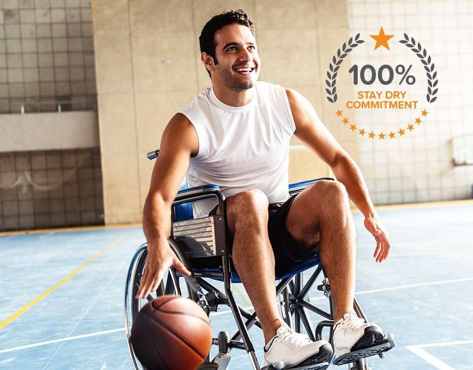 Man in a wheelchair bouncing basketball