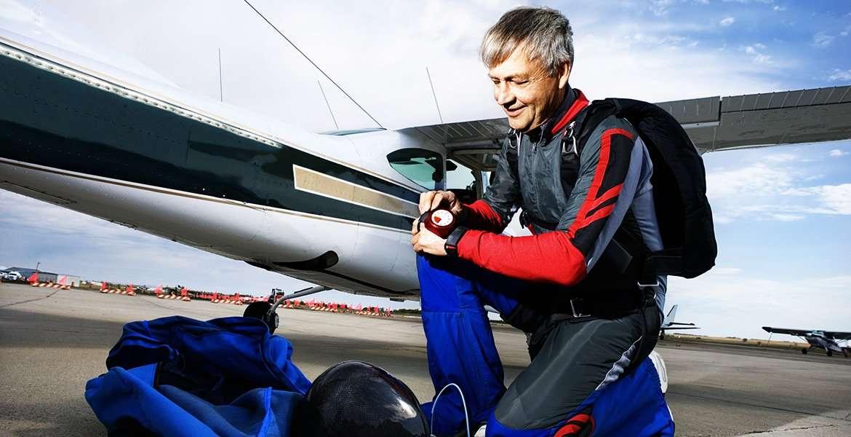 Older man preparing to go skydiving