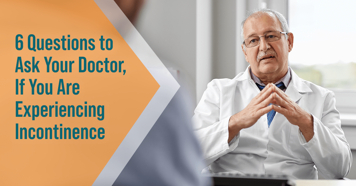 Older male doctor answering patients questions